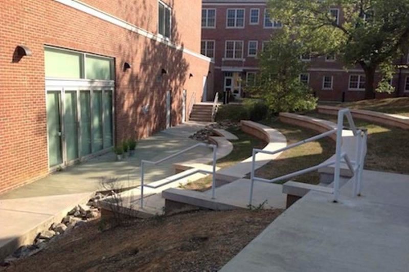 Small outdoor amphitheatre that faces the outer brick wall of an academic building on campus.